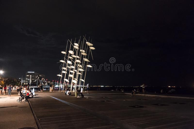 The sculpture Umbrellas by George Zongolopoulos located at the New Beach in Thessaloniki, Greece. Thessaloniki, Greece - July 25, 2018: The sculpture Umbrellas stock images