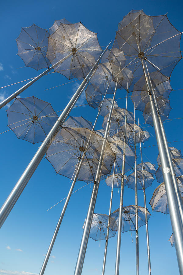 The sculpture Umbrellas by George Zongolopoulos in Thessaloniki. The sculpture Umbrellas by George Zongolopoulos,located at the New Beach in Thessaloniki, Greece royalty free stock image
