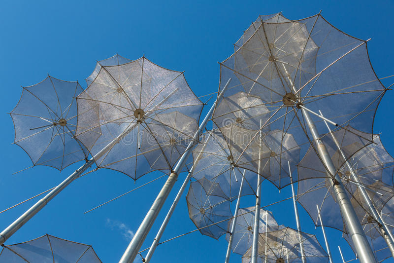The sculpture Umbrellas by George Zongolopoulos in Thessaloniki. The sculpture Umbrellas by George Zongolopoulos,located at the New Beach in Thessaloniki, Greece stock image