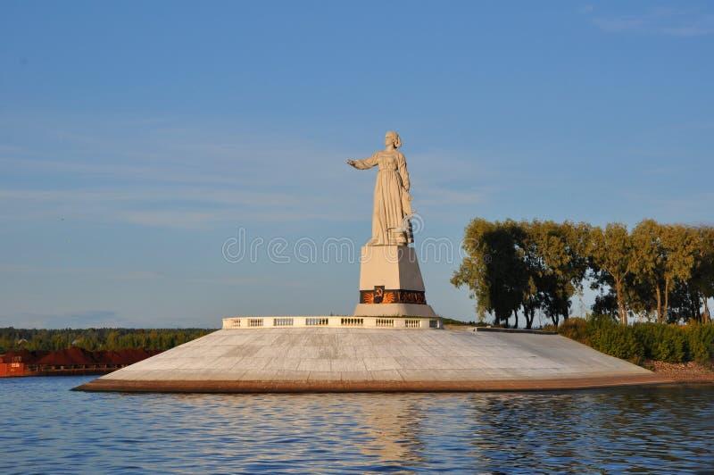 Sculpture Volga Mother on Rybinsk reservoir, Yaroslavl region, Russia. Sculpture Volga Mother in rays of the sun on Rybinsk reservoir in Rybinsk city, Yaroslavl royalty free stock photos