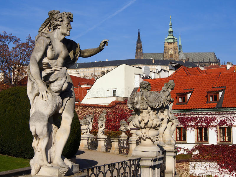 Sculpture in Vrtbovska Garden, view of the Prague castle. Middle terrace: the sculptural decoration of the garden, sunny day. Prague, Czech Republic stock image