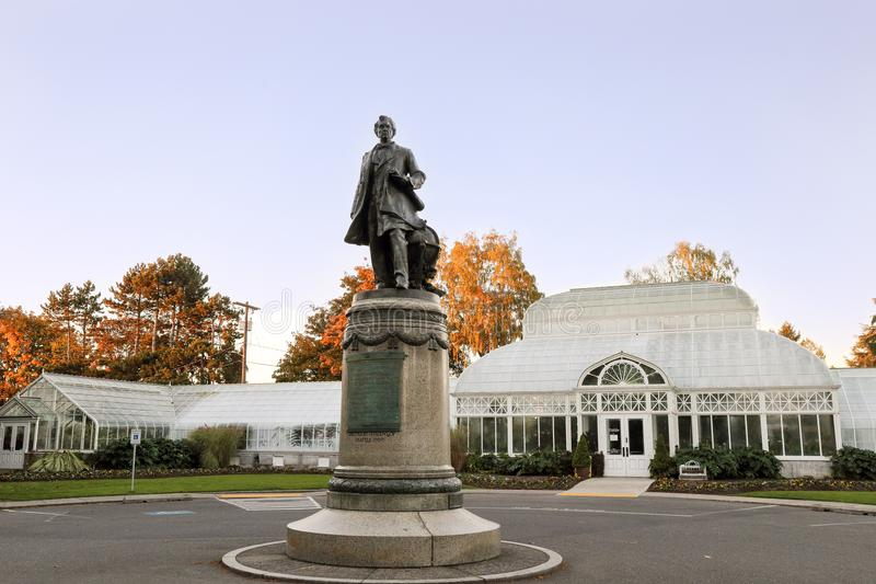 The sculpture of William Henry Seward at the Volunteer Park Conservatory. The sculpture of William Henry Seward in front of the Volunteer Park Conservatory stock images