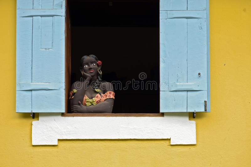 Sculpture of woman bust on blue window royalty free stock photo