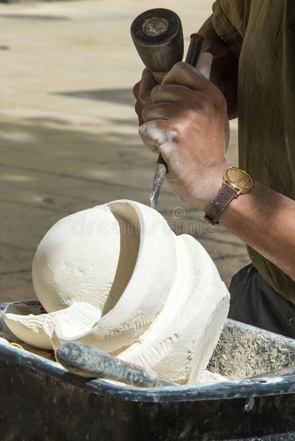 Block Of Stone For Sculpting : Sculpture at work hammer chisel stock photo image