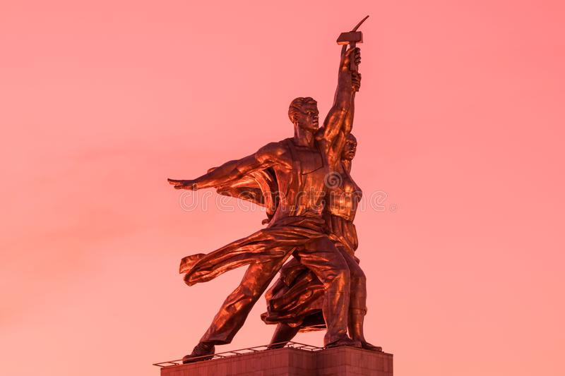 The sculpture of Worker and Kolkhoz Woman in Moscow, Russia on the background of setting sun royalty free stock photo
