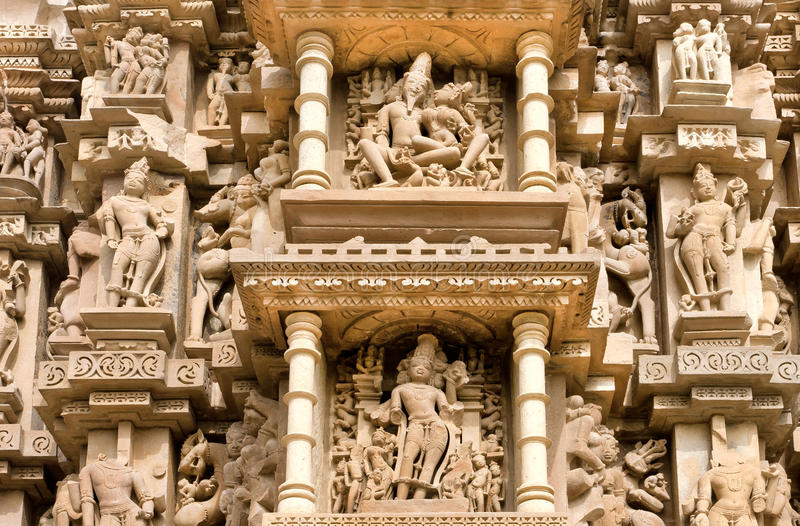 Sculptured surface of famous indian temple of Khajuraho with Hindu gods. UNESCO Heritage site stock photos