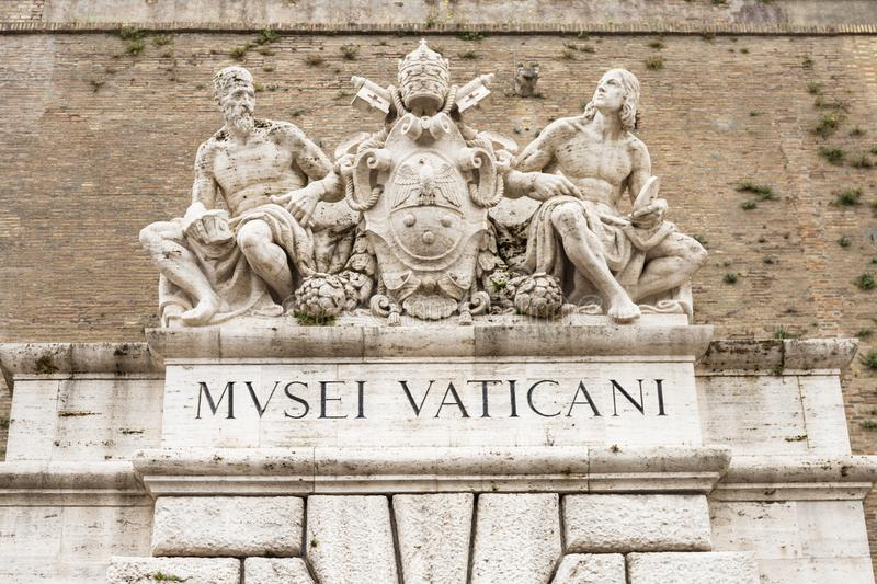 Sculptures above entrance to the Vatican Museums. royalty free stock image