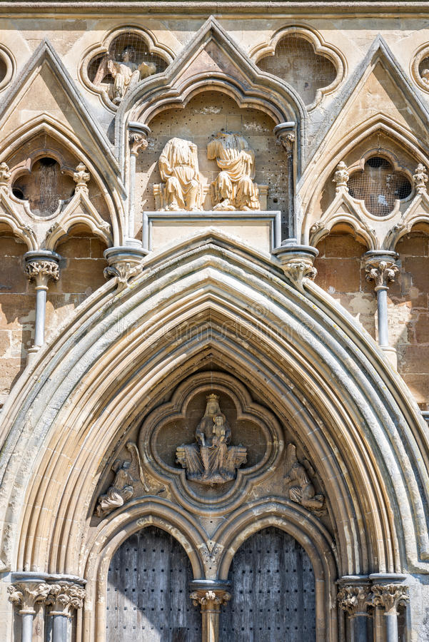 Sculptures above west door of Wells cathedral. Wells, United Kingdom - August 6, 2016: Sculpture of the Virgin and Christ Child above the west door of Wells royalty free stock image