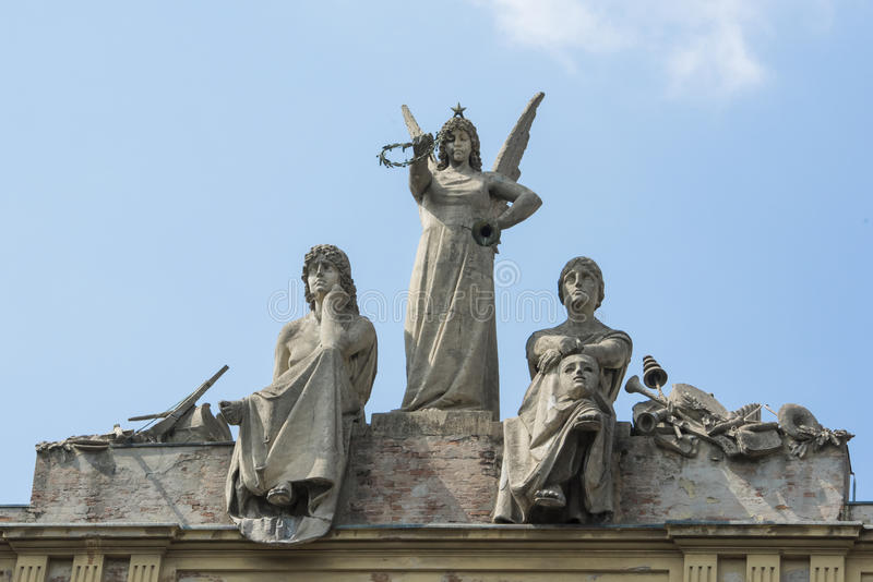 Sculptures of angel and actors on roof of Arena del Sole in Bologna stock photo