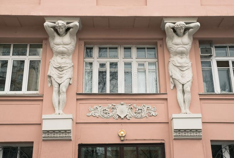 Sculptures of Atlantean. The sculptural decoration of the old residential building in Moscow royalty free stock image
