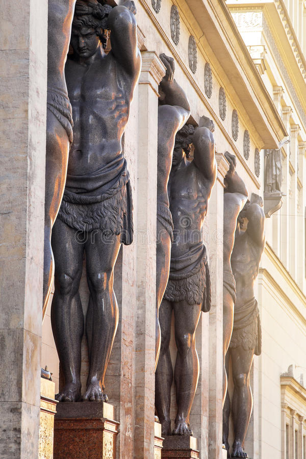 Sculptures Atlantes on porch of building Hermitage in St. Petersburg, Russia stock images