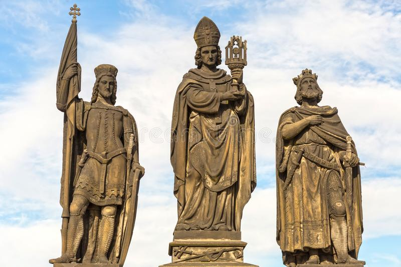 Sculptures Charles Bridge. Statues of three figures - Saint Norbert, St. Vaclav and St. Sigismund. Prague Czech February stock image