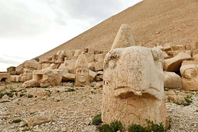 Sculptures of the Commagene Kingdom, Nemrut Mountain. The tomb or the Hierotheseion of Nemrut DaÄŸ bears unique testimony to the civilization of the kingdom of royalty free stock photo