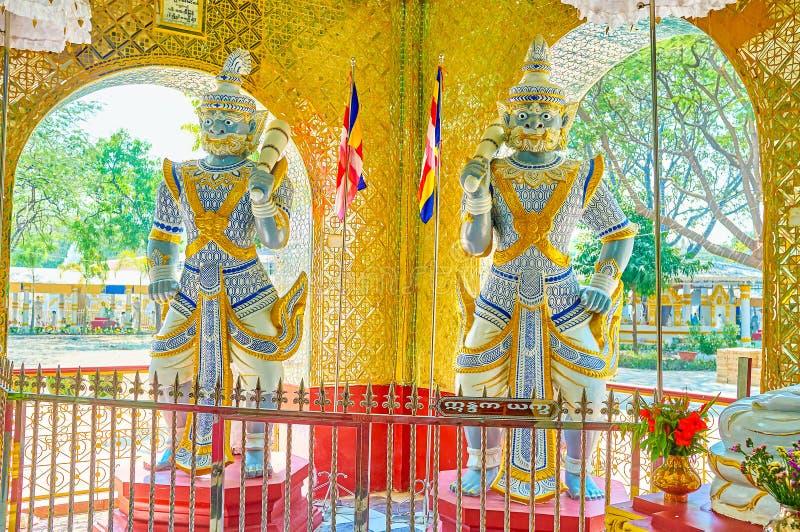 The sculptures of Demon King Totsakan, Kyauktawgyi Temple, Mandalay, Myanmar. MANDALAY, MYANMAR - FEBRUARY 23, 2018: The sculptures of guardians Domon Kings stock photo