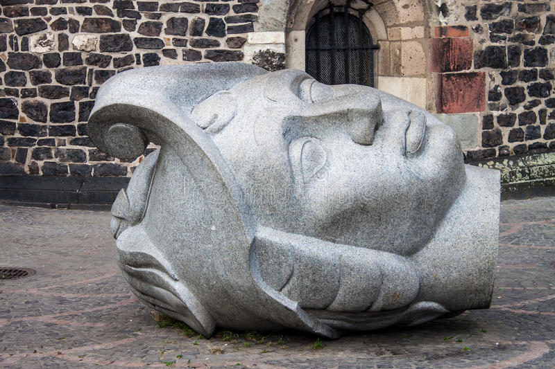 Sculptures depicting the heads of Saints Cassius & Florentius. In front of the Bonn Minster royalty free stock photography