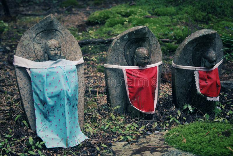 Sculptures in foorest cemetery at the top of the Mount Koya, Japan. Buddhist sculptures in forest cemetery on the top of Koyasan, saint and peaceful place, green royalty free stock photography