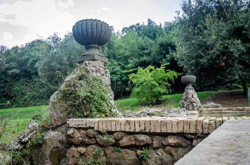 Sculptures fountain from which the water flows into the artificial lake in park at Vila Pamphili in Rome, capital of Italy. Sculptures fountain from which the royalty free stock photography
