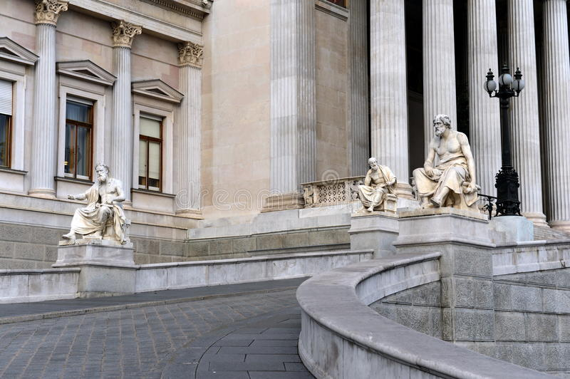 Sculptures of Greek philosophers at the Parliament building of Austria. VIENNA, AUSTRIA - NOVEMBER 30, 2012:Sculptures of Greek philosophers at the Parliament royalty free stock photos
