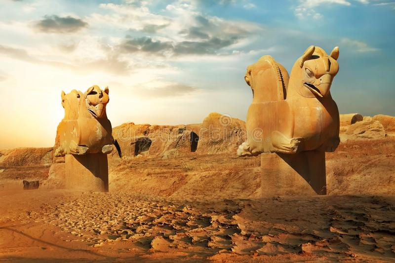 Sculptures of griffins in ancient Persepolis against the backdrop of the rising sun. Iran. Ancient Persia royalty free stock photography