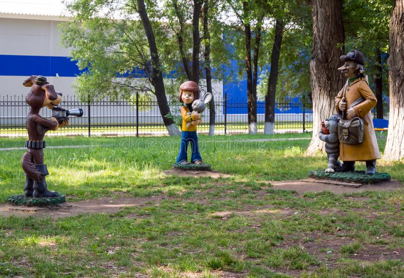 Sculptures of the heroes of the cartoon `Three from Prostokvashino.` City park of Zadonsk royalty free stock photo