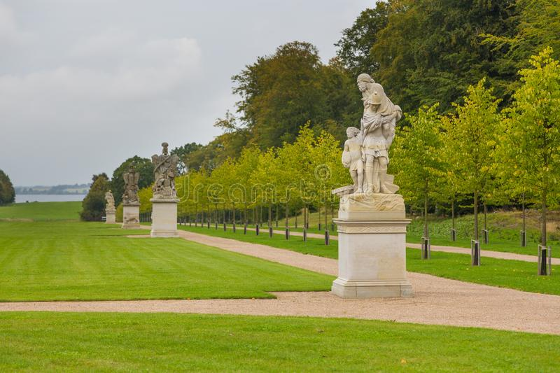 Sculptures in historical, Palace gardens, Fredensborg, Denmark. Fredensborg, Denmark- 30 August 2014: Sculptures in Palace gardens. The largest historical royalty free stock image
