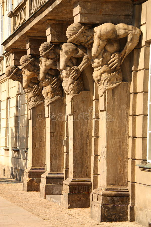 SCULPTURES ON OLD BUILDING stock images