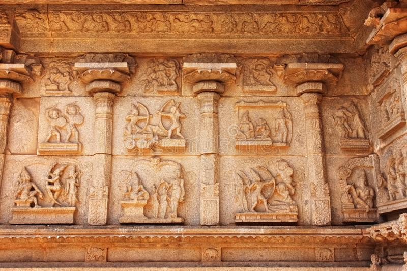 Sculptures in the wall of ancient Hindu temple in the ruins in Hampi India stock images