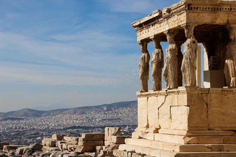 Sculptures of women in the temple complex Acropolis in Athens royalty free stock photo