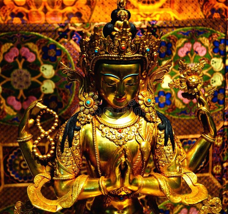 Scultura del Avalokiteshvara quattro-armato immagini stock