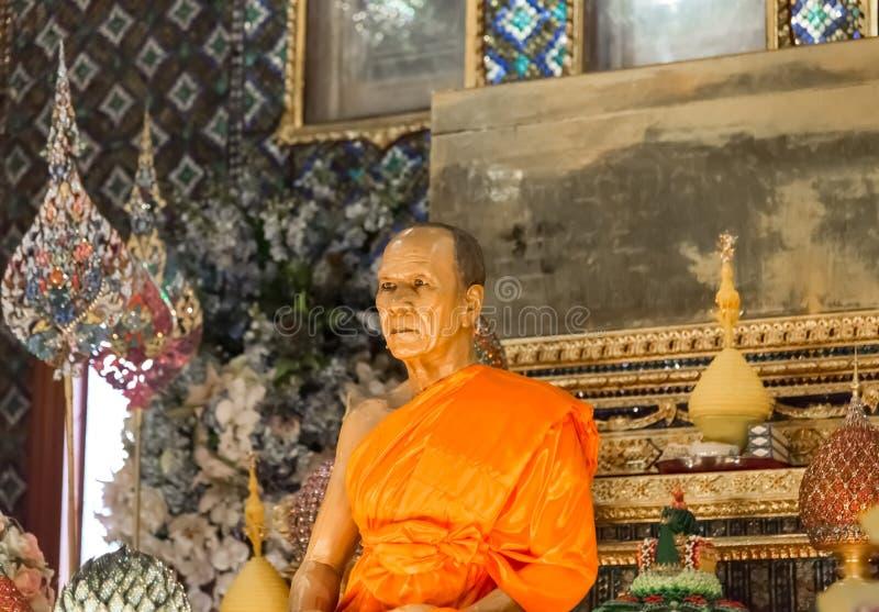 Scultura della cera dell'abbot in Wat Paknam Thailand fotografia stock
