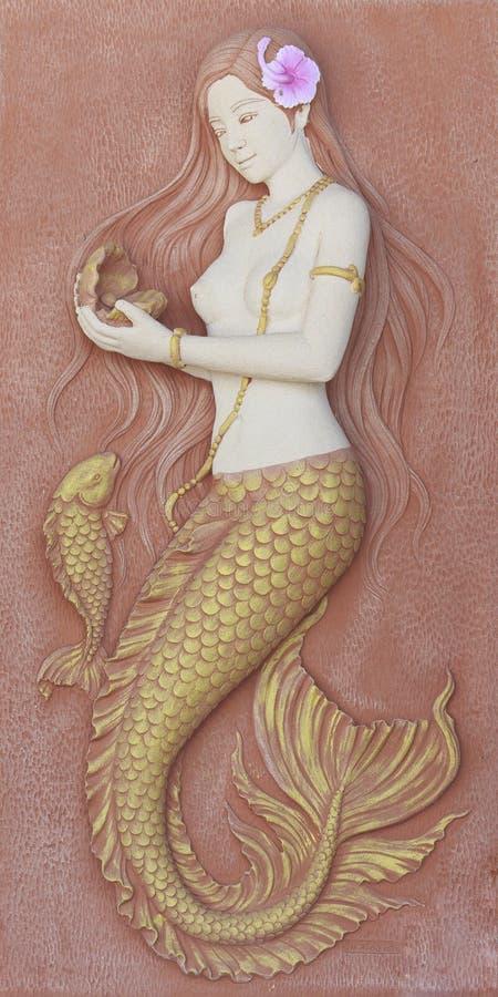 Scultura della sirena sulla parete fotografie stock libere da diritti
