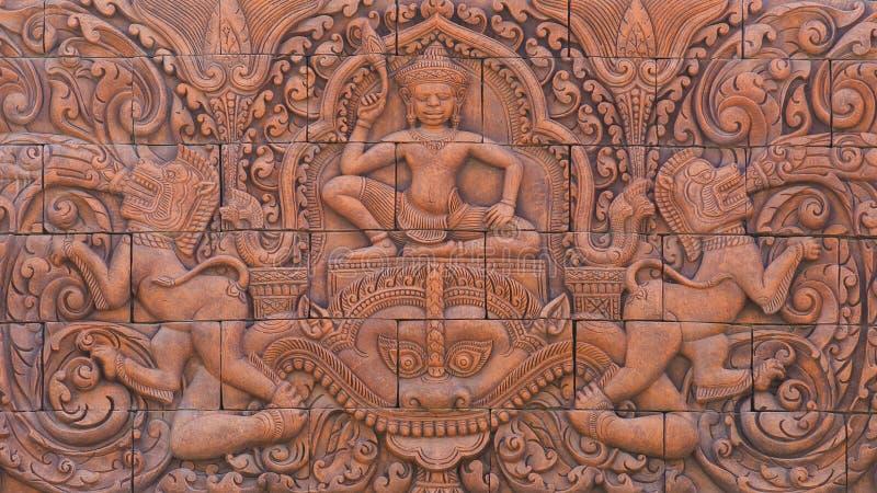 Scultura di pietra della cultura sulla parete fotografia stock