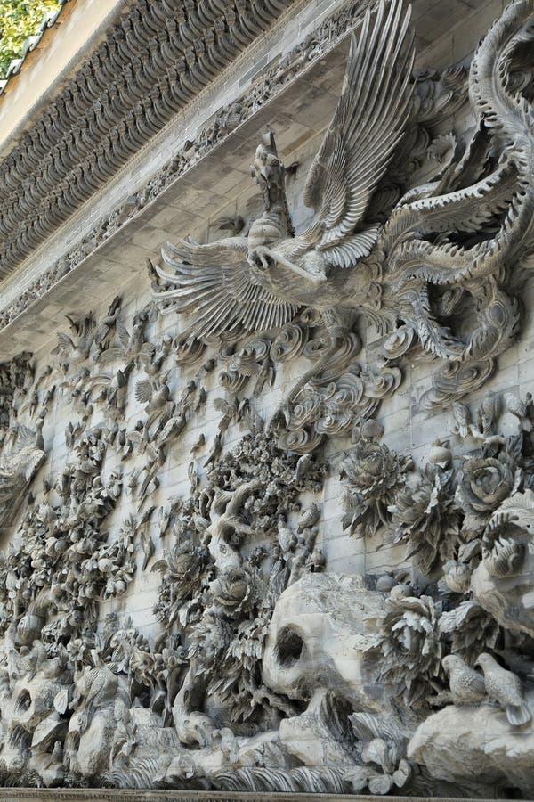 Scultura di pietra tradizionale cinese dell'Asia con il modello classico della Cina, parete di pietra scolpita singolare antica o fotografie stock