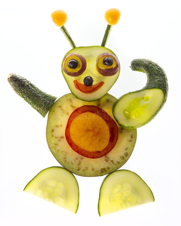 scultura felice dalla verdura immagine stock