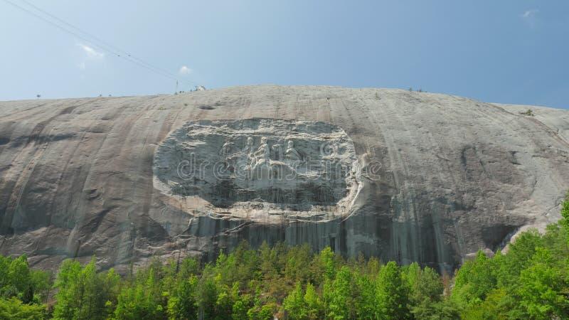 Scultura nel lato della montagna di pietra fotografia stock libera da diritti
