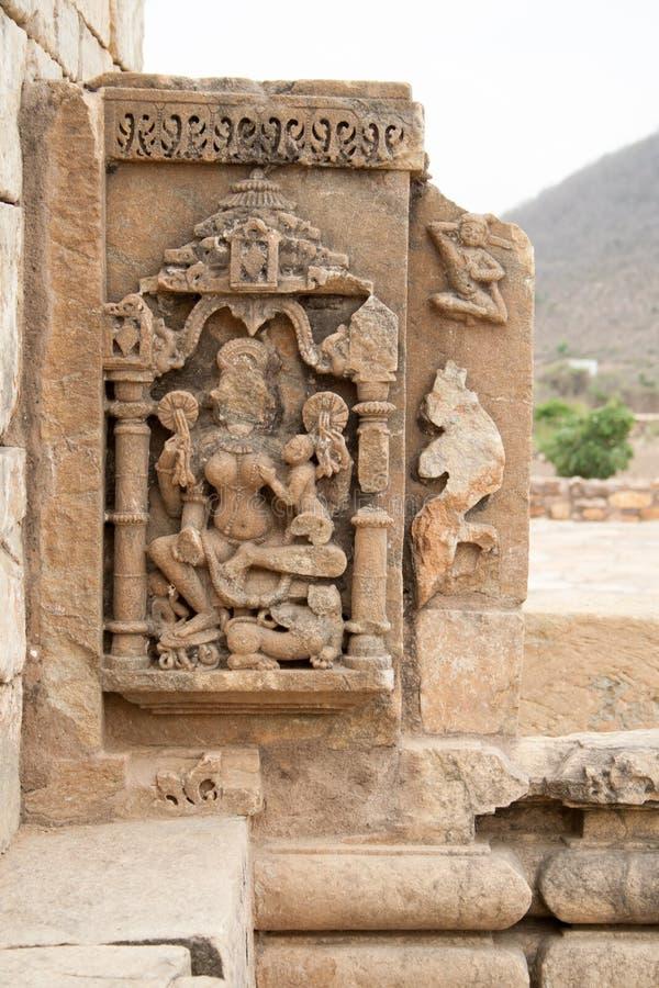 Scultura scolpita pietra ad un vecchio sito archeologico fotografie stock