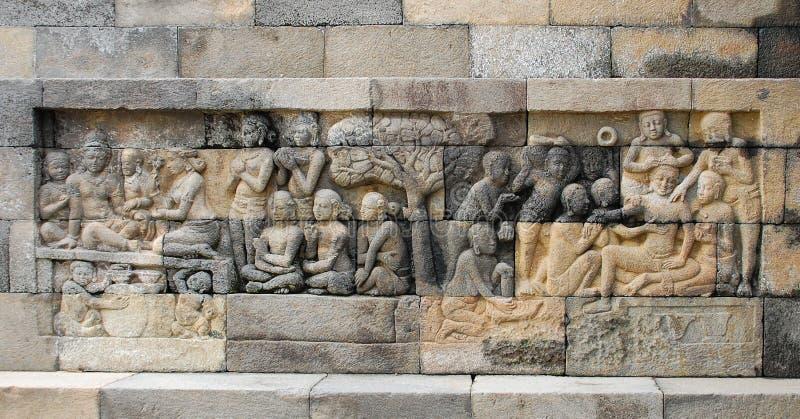 Sculture di Bas-relief in Borobudur immagine stock