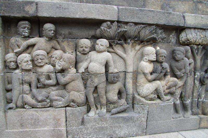 Sculture nel tempio di Borobudur in Indonesia fotografia stock