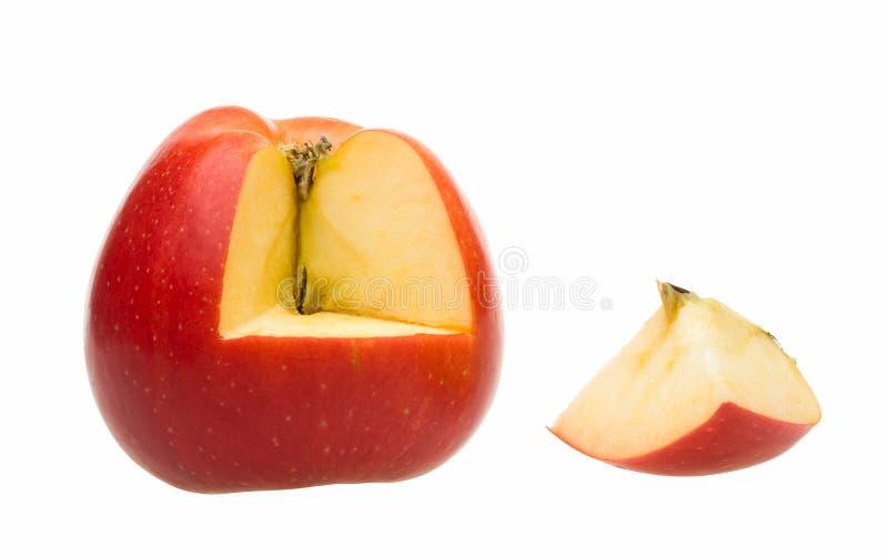 Seção de um quarto inteira da maçã e do entalhe imagem de stock royalty free