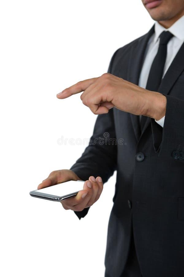 Seção meados de do homem de negócio que usa o telefone esperto imagens de stock royalty free