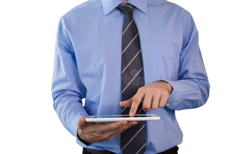 Seção meados de do homem de negócios que usa o PC da tabuleta imagem de stock