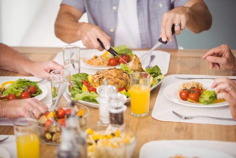 Seção mestra da família que come o café da manhã imagens de stock royalty free
