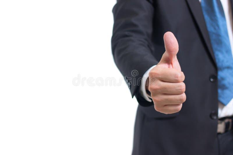 Seção mestra do close up da mão do homem de negócios que mostra os polegares acima do sinal contra isolado no fundo branco fotografia de stock royalty free