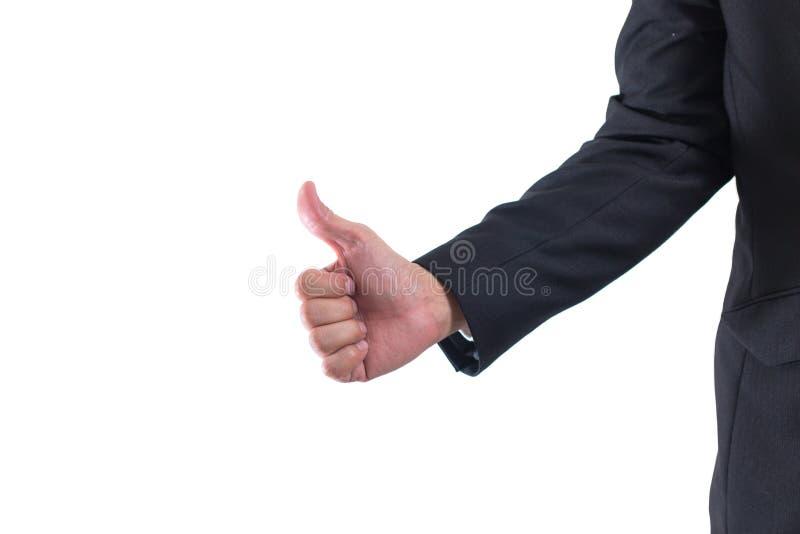Seção mestra do close up da mão do homem de negócios que mostra os polegares acima do sinal contra isolado no fundo branco imagem de stock royalty free