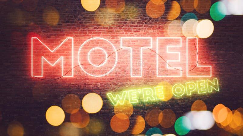 Señal de neón del motel montada en la pared de ladrillo libre illustration