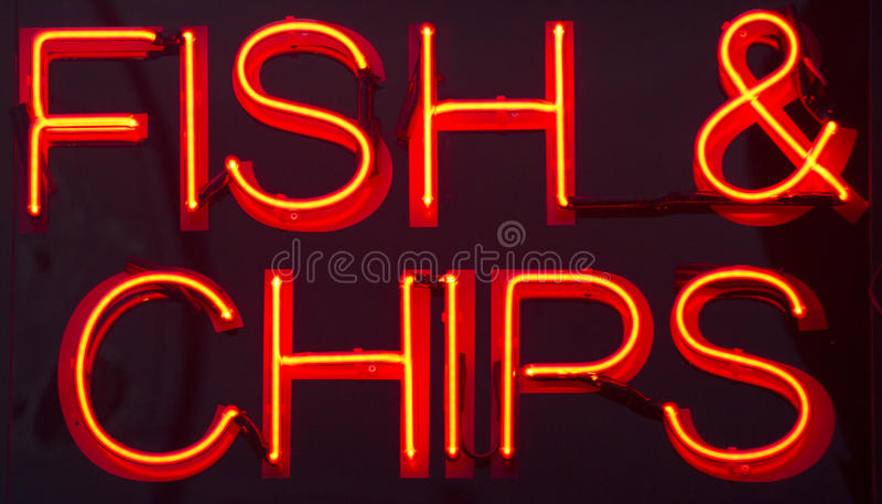 Señal de neón del restaurante de los pescado frito con patatas fritas imagen de archivo libre de regalías