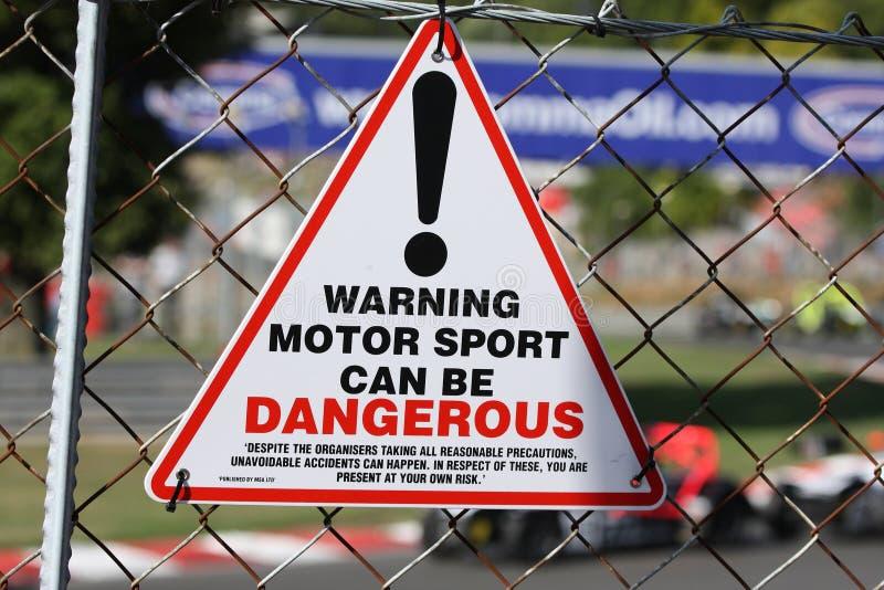 Señal de peligro del Motorsports fotografía de archivo libre de regalías