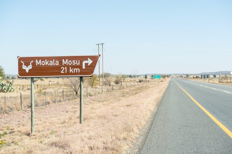 Señal de tráfico al parque nacional de Mokala foto de archivo