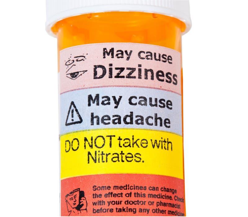 Señales de peligro en la botella de drogas del rx imagen de archivo