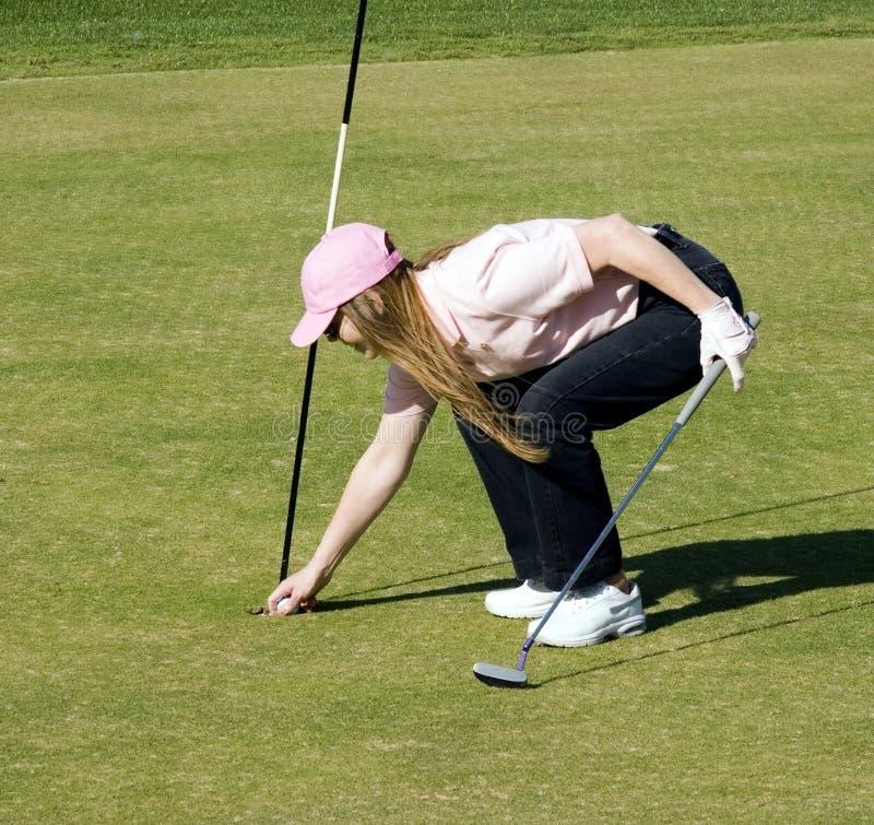 Señora afortunada Golfer imagen de archivo libre de regalías